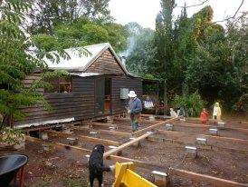 the building site - the verandah has been taken off, piers buried in the ground.