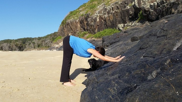 A little bit of rock and sand yoga on our beach walk.