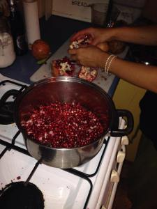 Making pomegranate syrup.