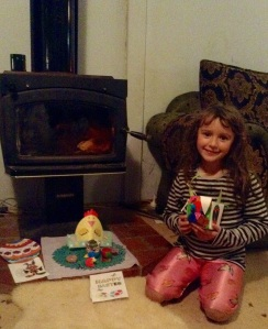 My daughter and her altar to All Things Easter.