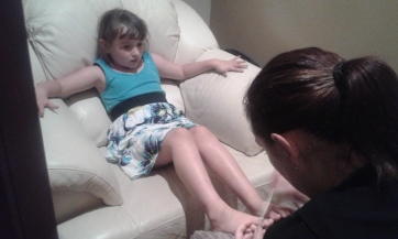 Getting her toe nails painted :)