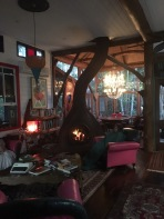 A cosy evening scene in the Alice in Wonderland-esque lounge and dining room