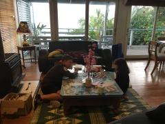 Nick teaching Alani to play chess